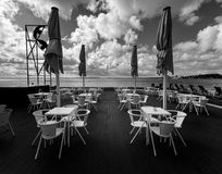 The embankment of Lisbon. Portugal. Black and white. The cafe is waiting for guests. The tables and chairs are still empty. Lisbon at dawn Royalty Free Stock Images