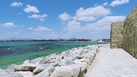 The embankment is made of stone - under the bright sunlight of the city of Hammamet, Tunisia. royalty free stock photo