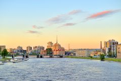Embankment of Malaya Nevka River at sunset. Royalty Free Stock Photo