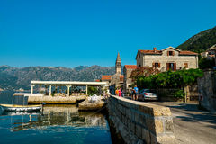 An embankment with medieval stone houses Royalty Free Stock Photo