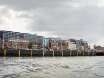 Embankment and modern buildings  in Amsterdam. Netherlands Royalty Free Stock Image