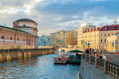 Embankment of Moika river and historic buldings at sunset in St Petersburg, Russia Royalty Free Stock Image