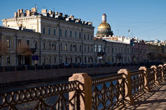 Embankment of Moika river in Saint-Petersburg. Embankment of Moika river and dome of  Saint Isaac`s Cathedral in Saint-Petersburg, Russia Stock Photography