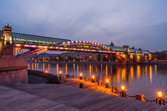 Embankment of the Moscow river. Andreevsky Bridge in the evening. Autumn 2013. Russia. Moscow. Central Park of Culture and Rest named after Gorky. Embankment of Stock Photography