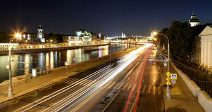 Embankment of the Moskva River and the night traffic, Moscow, Russia Stock Photos