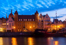 Embankment of Motlawa in Gdansk. Night in Gdansk - old town waterfront with sailing ship illuminated in night, Gdansk, Poland Stock Image