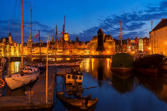 Embankment of Motlawa in Gdansk. Night in Gdansk - old town waterfront with ships harbor illuminated in night, Gdansk, Poland Royalty Free Stock Photos