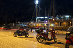 Embankment and neon lights bikes boats in Makarska, Crovatia Royalty Free Stock Photography