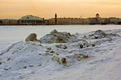 Embankment of the Neva River in the evening. Old Saint Petersburg Stock Exchange and Rostral Columns. Winter cityscape Royalty Free Stock Image