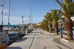 embankment with palm trees and yachts in Argostoli town Stock Photos