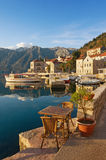 Embankment of Perast town. Montenegro. Embankment of Perast town on a sunny winter day. Bay of Kotor, Montenegro Stock Photos