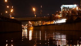 Embankment,  reflection in water,  motion night scene stock footage