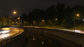 Embankment,  reflection in water. Motion night scene Stock Photo