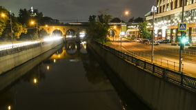 Embankment,  reflection in water,  motion night scene. Time lapse stock video footage