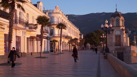 Embankment resort town in the early morning. Sunrise in the city. Yalta, Crimea - December 23, 2016: Embankment resort town in the early morning. Sunrise in the stock footage