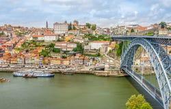 Embankment Ribeira of Douro River with bridge of Luis I. in Porto - Portugal Stock Photo