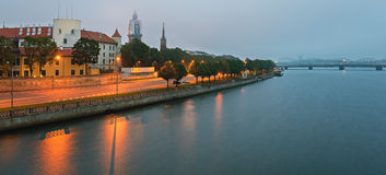 Embankment of Riga city with a view on old town, morning mist Stock Photos