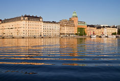 Embankment with ripples and reflections. Waterfront in Stockholm reflecting in the sea royalty free stock photos