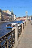 The embankment of the river Moika, pleasure boat and cast-iron f. Ence in Sunny day Stock Images