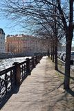 The embankment of the river Moika in the sun in early spring. The embankment of the river Moika in the sun Stock Photography