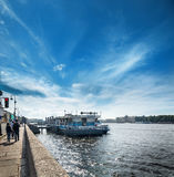 Embankment of the river Neva and a pier in front of St. Isaac`s Royalty Free Stock Images