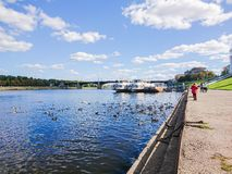 Embankment of the river Volga in Tver, Russia. Autumn Sunny day. Pleasure boats at the pier. Wild Mallard ducks swim in the river Stock Images