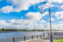 Embankment of the river Volga in Tver, Russia. View of the left Bank of the river. Picturesque clouds in the sky. The Monastery Of St. Catherine stock photos