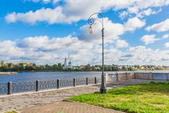 Embankment of the river Volga in Tver, Russia. View of the left Bank of the river. Picturesque clouds in the sky. The Monastery Of St. Catherine royalty free stock photo