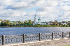 Embankment of the river Volga in Tver, Russia. View of the left Bank of the river. Picturesque clouds in the sky. The Monastery Of St. Catherine stock images