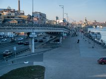 Embankment riverside of Dnipro river near boat station at Poshtova square with car bridge. KYIV, UKRAINE - MARCH 13, 2019: Embankment riverside of Dnipro river stock photography