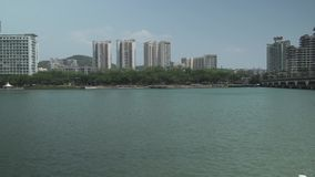 Embankment of the Sanya River in Sanya City on Hainan Island stock footage video stock video