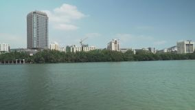 Embankment of the Sanya River in Sanya City on Hainan Island stock footage video stock footage