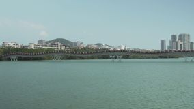 Embankment of the Sanya River in Sanya City on Hainan Island stock footage video stock video footage