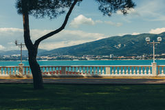 Embankment at the sea shore against the backdrop of picturesque mountains walking along the waterfront concept. Gelendzhik, North Caucasus, Russia Stock Photos
