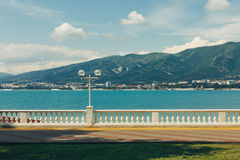 Embankment at the sea shore against the backdrop of picturesque mountains walking along the waterfront concept. Gelendzhik, North Caucasus, Russia Stock Photography