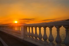 Embankment at sea at sunset Royalty Free Stock Photography