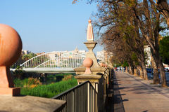Embankment of Segura river and Puente del Hospital Stock Photo