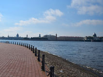 Embankment in St. Petersburg, fence poles in the foreground, the Neva River and landmarks St. Isaac's Cathedral, Admiralty, Rostra Stock Photography