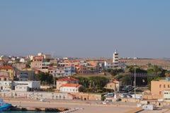 Embankment, station, city and beacon. Porto-Torres, Italy. Embankment, raiway station, city and beacon. Porto-Torres, Italy; 04-07-2017 Royalty Free Stock Images