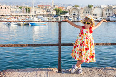 Embankment. Thoughtful girl stands on the promenade by the sea Royalty Free Stock Photo