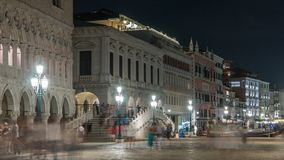 Embankment to the bridge Ponte della Paglia timelapse near Palace of the doges and the palazzo delle Prigioni at night. A favorite place for walking tourists stock video