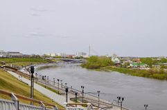 The embankment in Tyumen. Spring flood of the Tura River. Royalty Free Stock Photos