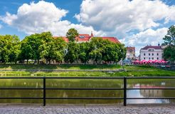 Embankment of Uzh river in summer. Uzhgorod, Ukraine - Jun 15, 2017: embankment of Uzh river in summer. Beautiful architecture and blossoming linden trees on stock photography