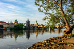 Embankment of the Vltava River with a view of the Charles Bridge in Prague, Czech Republic Stock Images