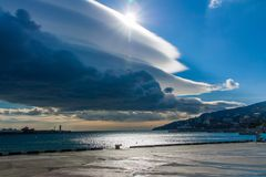 Embankment of Yalta in the clouds and sun Royalty Free Stock Photography