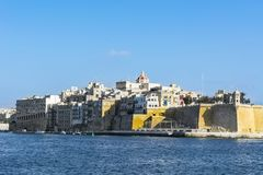 Embankments of Malta with berths. For yachts and boats. Buildings with traditional colorful maltese balconies in historical part of Valletta Stock Images