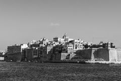 Embankments of Malta with berths. For yachts and boats. Buildings with traditional colorful maltese balconies in historical part of Valletta. Black and white Royalty Free Stock Images