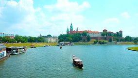 The main Landmark of Krakow, Poland. Embankments of Vistula River is the best place to have a rest in one of a numerous floating restaurants, watching the Wawel stock footage