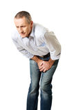 Embarassed man covering his painful crotch Stock Photography