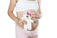 Embarazada con el oso de peluche Fotos de archivo libres de regalías